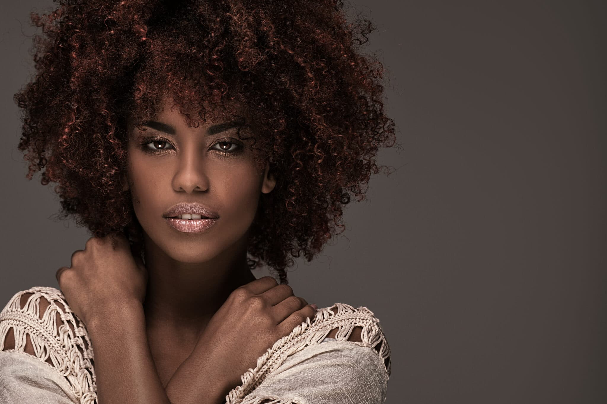 Beauty portrait of african american woman with afro hairstyle and glamour makeup.
